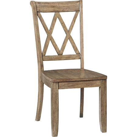 Pairing a latticework back and weathered gray finish, this wood side chair lends a rustic touch to your kitchen or dining area. Prod...