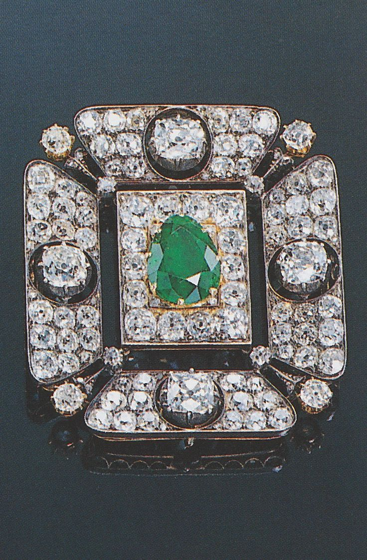 An antique emerald and diamond brooch / pendant, late 19th century. The almost square, buckle shaped diamond-set frame enhanced by four larger cushion shaped diamonds with a single pear shaped emerald in the centre, mounted in silver and gold, retractable pendant loop, brooch fitting detachable. Source: Sotheby's Magnificent Jewels, St. Moritz, 22 February 1997. #antique #brooch #pendant