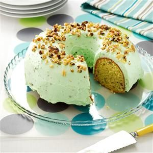 Pistachio Pudding Cake Recipe -This recipe has been under lock and key for years in our family. Everyone who's ever tried this moist, one-of-a-kind cake can't believe it's a mix. The dessert is perfect for St. Patrick's Day…and you won't need the luck of the Irish to whip it up! —Suzanne Winkhart, Bolivar, Ohio