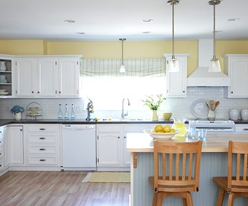 Yellow walls yellow and white cabinets on pinterest for Caulking around kitchen cabinets