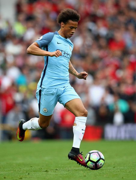 Leroy Sane Photos Photos - Leroy Sane of  Manchester City in action during the Premier League match between Manchester United and Manchester City at Old Trafford on September 10, 2016 in Manchester, England. - Manchester United v Manchester City - Premier League