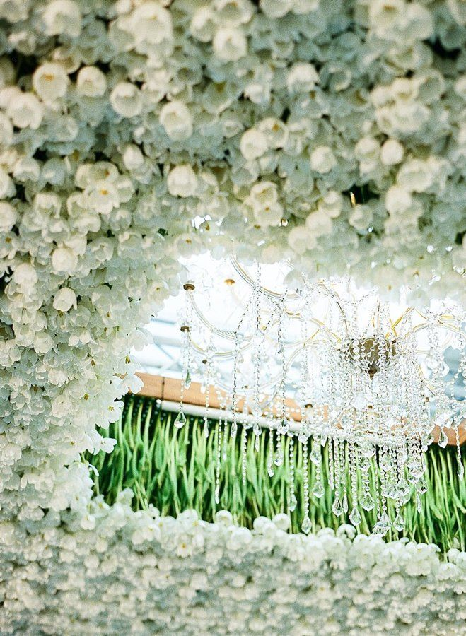 Wedding chandelier and tulips http://www.stylemepretty.com/2017/04/04/a-lavish-soiree-in-new-orleans-french-quarter/ Photography: A Bryan Photo - http://www.abryanphoto.com/