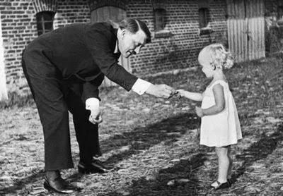 Little girl giving flowers to Uncle Hitler