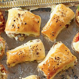 Mushroom Puffs | SouthernLiving.com - Flaky puff pastry envelopes a rich mix of cream cheese, mushrooms, onions, and Parmesan cheese. You can even assemble and freeze these ahead of time.