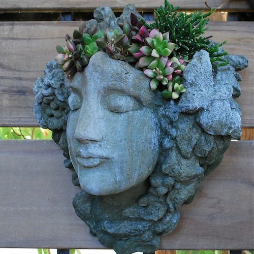 head planters, not available at this site, but great idea--planting with sediums, The best of these planters are usually concrete cast and heavy...anchoring care a must. Mine is on the living room wall, I love it so much...