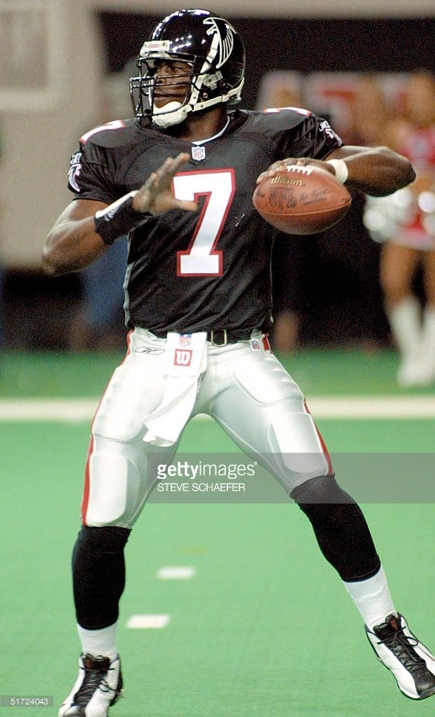 Michael Vick's first ever NFL game  http://media.gettyimages.com/photos/atlanta-falcons-rookie-quarterback-michael-vick-throws-downfield-picture-id51724043