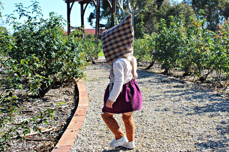 Exploring the Rose Garden. Aster is wearing her cotton cord Dear Dahlia Skirt, Knee High Socks, Pixie Hat and Suspenders making the perfect outfit for this Autumn and Winter