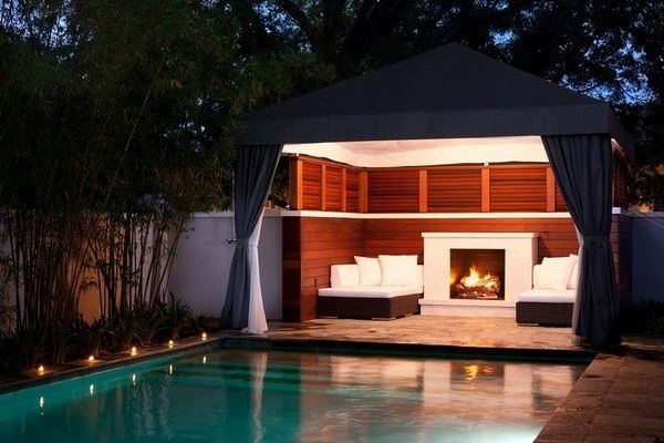 Pool house modern outdoor fireplace outdoor lounge furniture swimming pool outdoor lighting