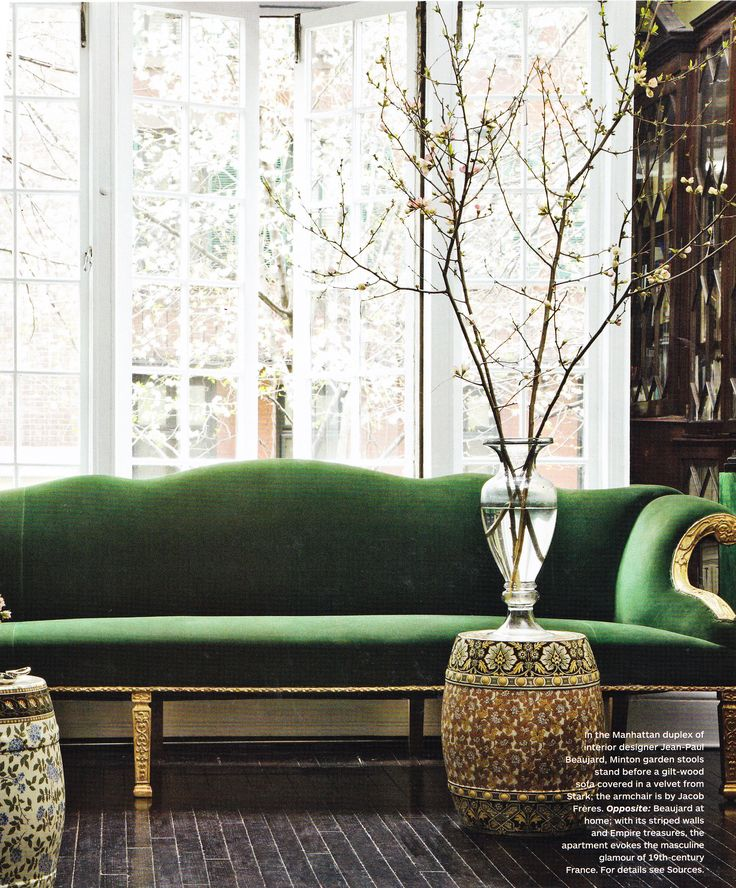I've been contemplating reupholstering my velvet camelback sofa in emerald green as of late. I think I'm sold.