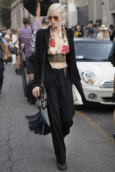abbey lee kershaw rocking boho chic, floral cropped plunging halter top, fringe shoulder bag