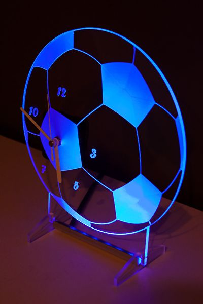 Clock with blue backlight LED in the shape of a football. New design.