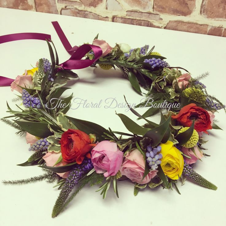 Floral crown of Spring flowers including Muscari, Ranunculus & Anemome. Bright & bold with contrasting trailing ribbon.
