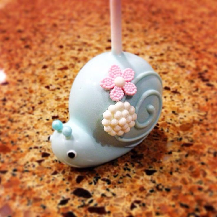 Cute Snail cake pop by Creative Edibles by Yuki
