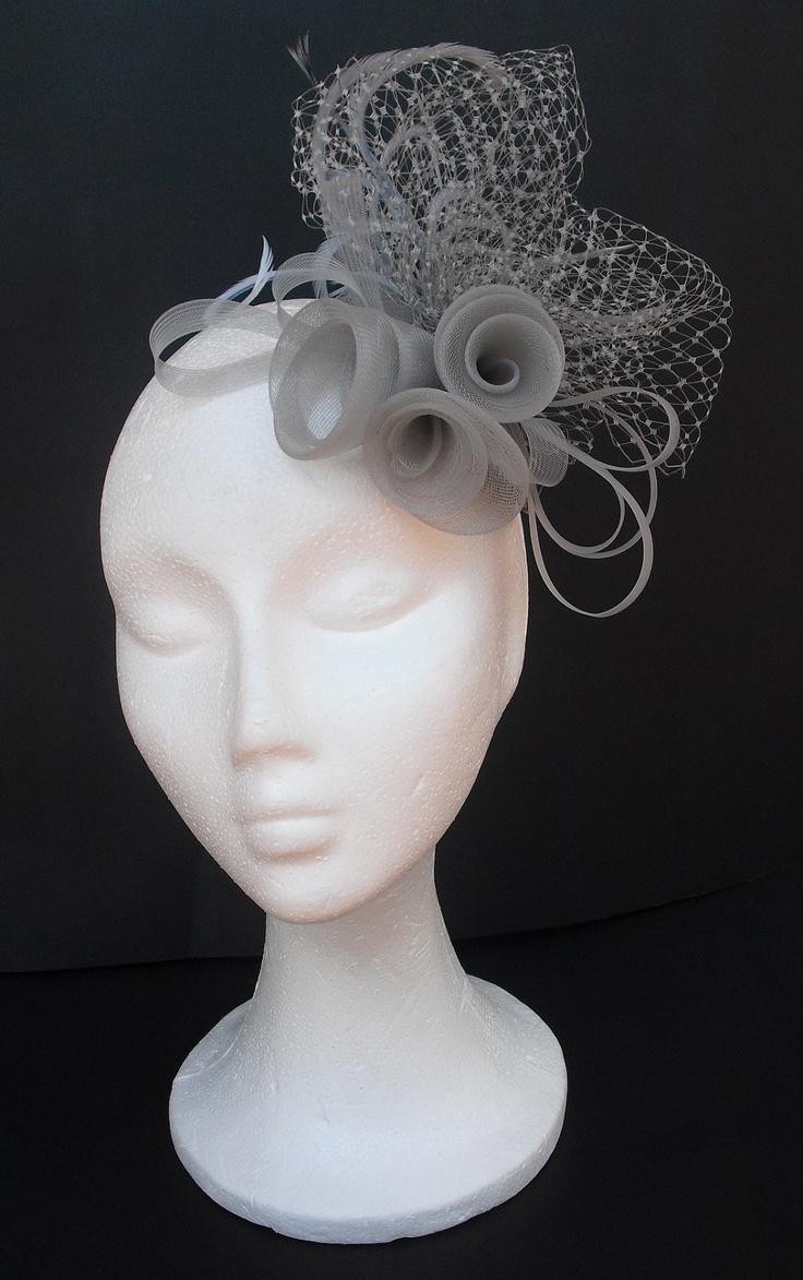 Grey fascinator headpiece /  Grey hat  /   Weddings  /  Cocktails  /   Kentycky Derby  /  Special occasions   /  Party. $76.00, via Etsy.