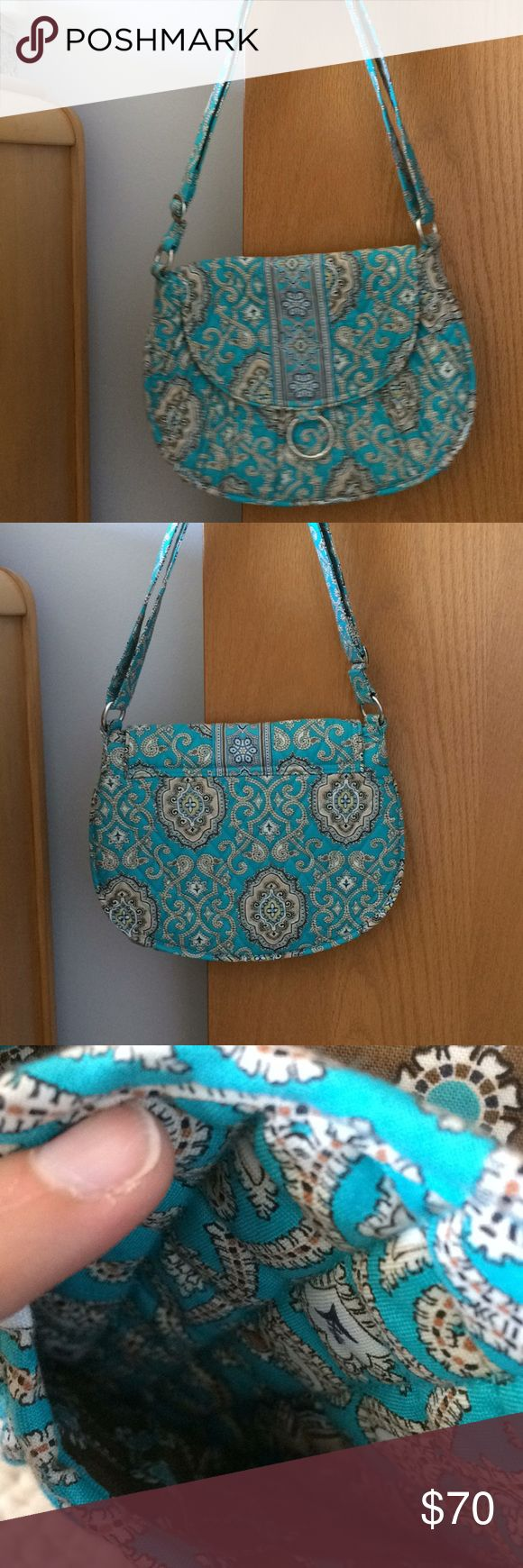 Vera Bradley saddle up Authentic Vera Bradley saddle up . Wonderful condition no tears or anything. This is the old style in saddle up and cannot find in stores . Used for two months . Vera Bradley Bags Shoulder Bags
