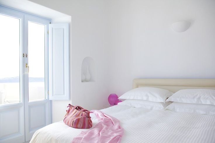 Fresh-Relax-White-Hotel-Bedroom-Purple-Alcodes-Wood-Bed-Santorini-Island-Greece
