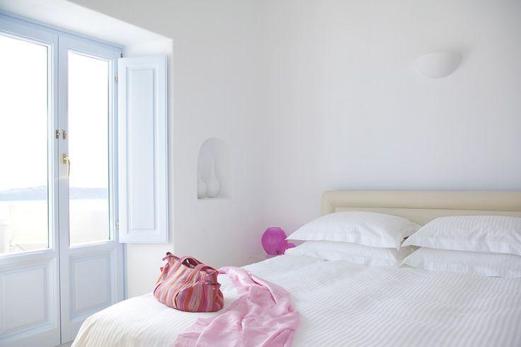 Fresh-Relax-White-Hotel-Bedroom-Purple-Alcodes-Wood-Bed-Santorini-Island-Greece