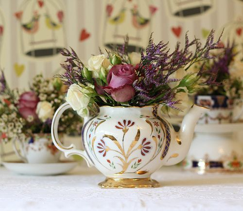 Mad Hatter wedding flowers. This kind of feel but in your colours for tables and dotted around the venue.