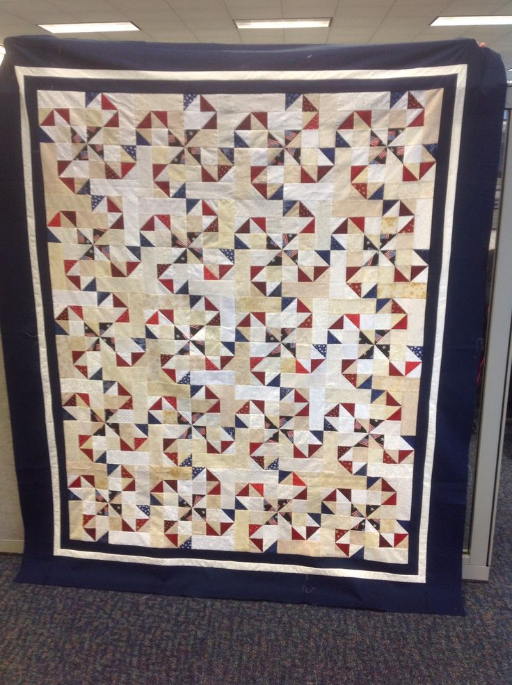 Oklahoma Twister Quilt with Navy flag pinwheel and red and blue hst. Should make a nice quilt of valor!