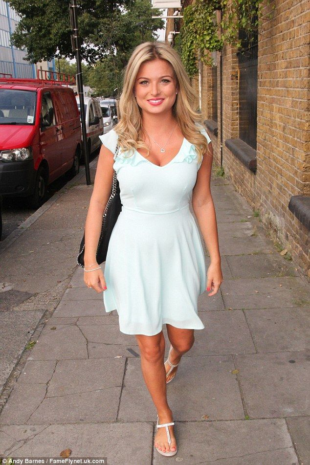 Putting on a brave face: Zara Holland brushed off the drama to stop off at the Fubar Radio studios in London on Thursday evening, looking demure in a baby blue dress