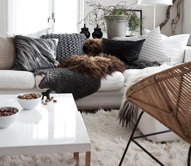 Selection of faux fur throws and pillows on couch living - Living room throw blankets ...