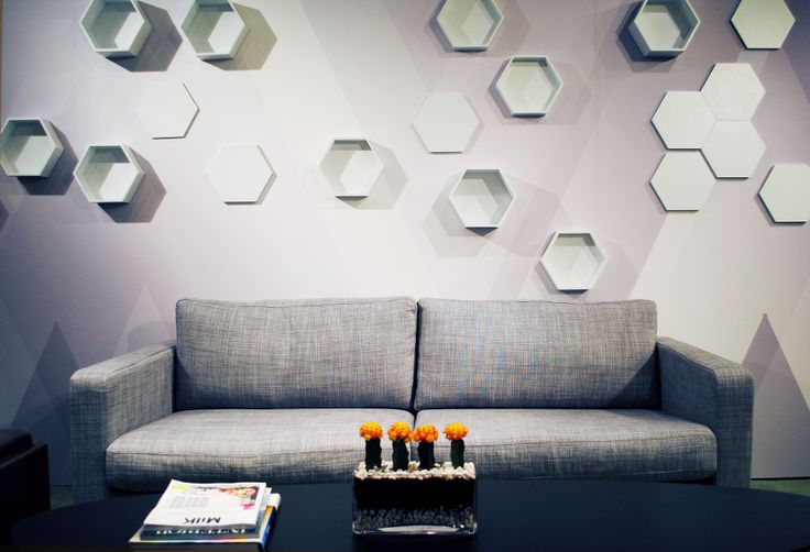 Visual Magnetics' Dynamic Spaces Magnetic honey comb wall sculpture shelving at NYC's Retail Design Collective 2012