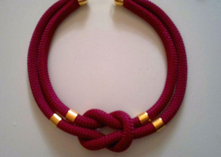 dark red gold element necklace