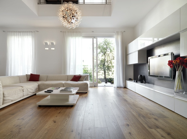 Living room with light hardwood floors. @ToscaSurfaces #modernliving