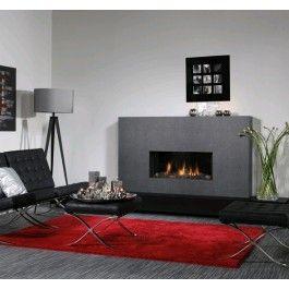 De #Faber Relaxed Premium M is een strakke inbouw #gashaard die dankzij de frameless ombouw een schitterende kijk geeft op het vlammenbeeld. De Faber Step Burner is op een unieke manier te regelen. Zo is bij een volledig vermogen over de gehele breedte van de haard het vuur te zien. Maar wanneer er minder warmte wordt gevraagd, concentreert het vuur zich in het midden van de brander. #Fireplace #Fireplaces