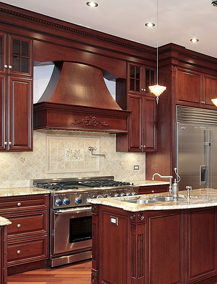 Stained cherry kitchen with wood hood and island. | Cherry ...