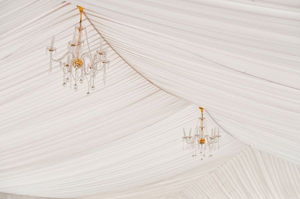 Two gold and crystal chandeliers used to style marquee
