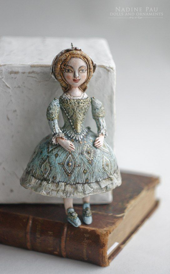 "Marie (collection of ""The Nutcracker"") by Nadine Pau. Christmas ornaments. Papier mache, oil patina varnish. Sold #christmasornaments #nadinepau"