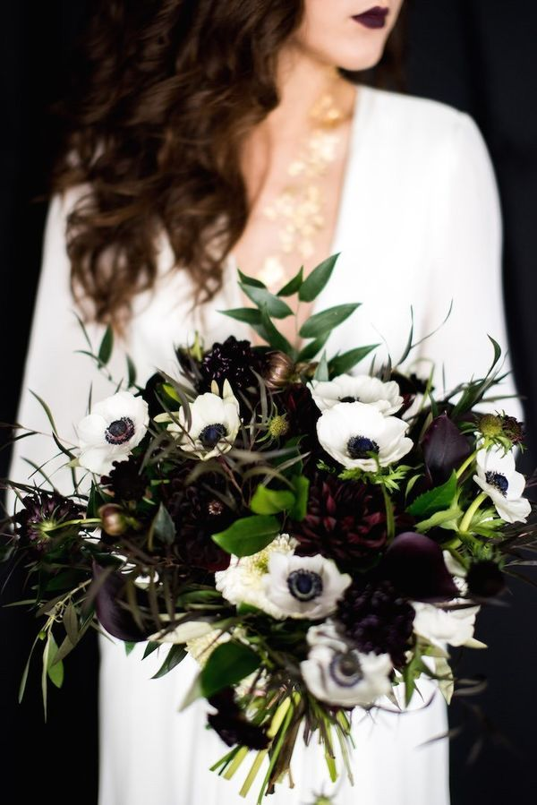"Anemones are a great choice for a black and white wedding idea. With an anemone wedding bouquet, enhance them with deep eggplant flowers like these dahlias that will ""read"" as black as seen in this modern bridal bouquet."