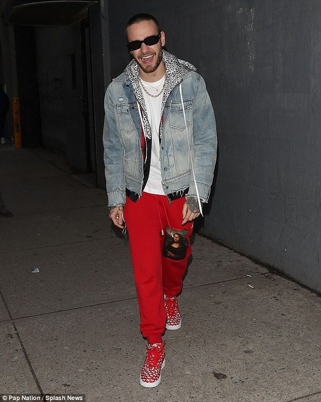 Liam Payne delights fans in eccentric outfit in New York  He was spotted with a beautiful woman on his lap.  But Liam Paynes girlfriend Cheryl need not worry it was just the Mona Lisa adorning his pants on Tuesday night.  The da Vinci masterpiece on the 24-year-olds thigh was part of his Off-White sweat-pants which in turn was just one part of an eye-catching ensemble.  Work of art! Liam Payne delighted fans in an eccentric outfit as he left the recording studio in New York  The singer paired th