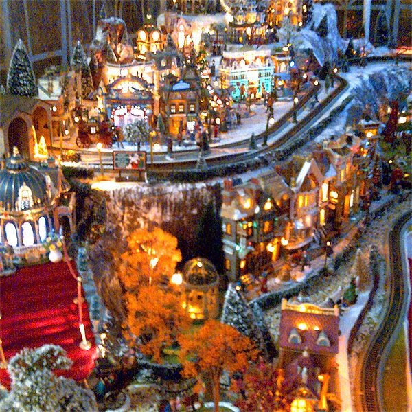 very nicely done!  I would love for my village to look like this!  I may have to get two more trains though.