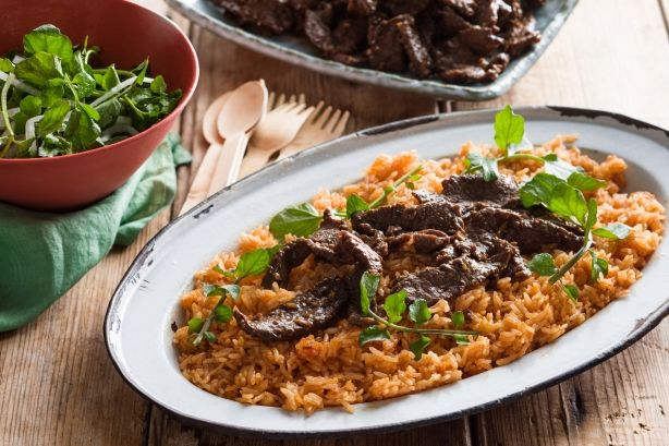 Vibrant red rice complements the fiery and flavoursome beef strips in this Vietnamese dish.