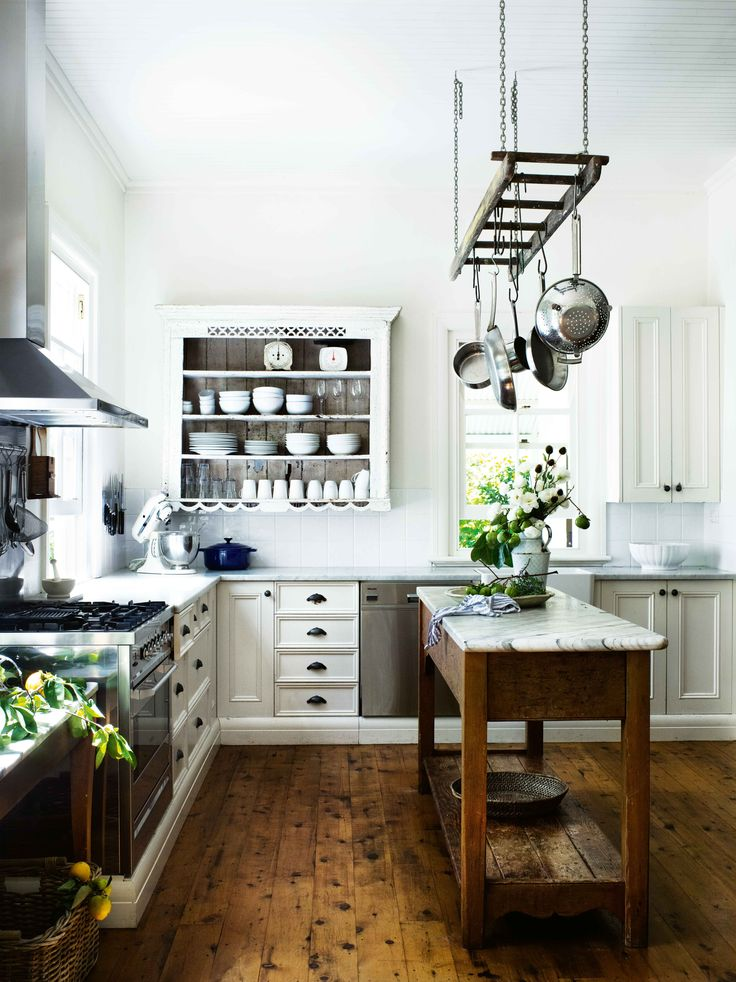 Dream kitchen. Marble work surfaces, shelves and a freestanding island bench.   June 2016 issue. House, Berry, NSW. Precious moments. Photography Brigid Arnott, styling Vanessa Colyer Tay.