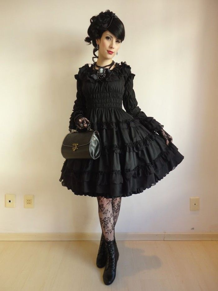 frilly black dress, with lace trims, worn over black, meshy sheer tights,  with floral shapes, define lolita, on a young woman with black hair, ... e4552d3ed4