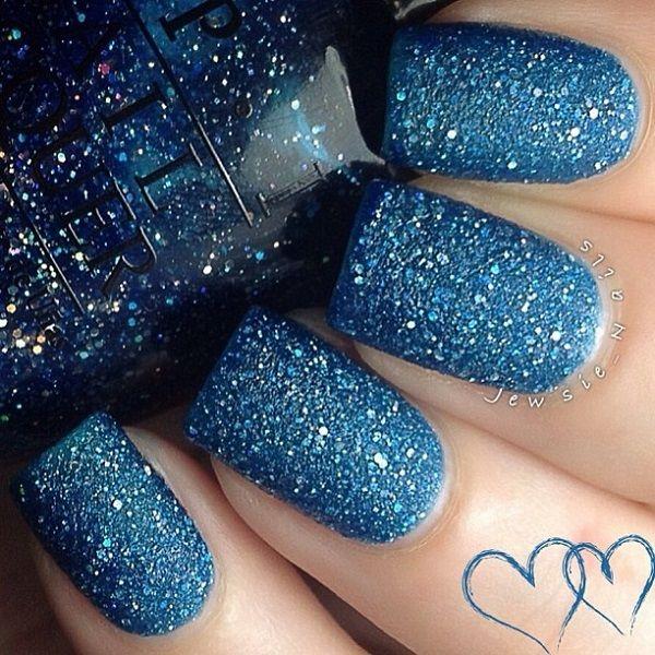 Sparkling full glitter matte nail art design in mesmerizing aqua blue glitters.