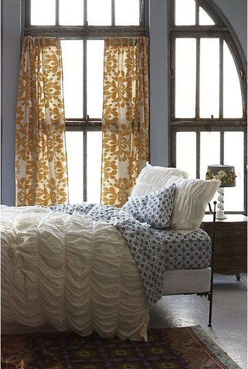 pretty patterned curtains + sheets...just the right amount of pattern to be fun, but not overwhelming.