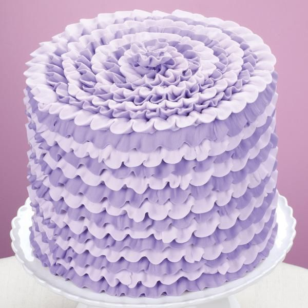Party-Ready Violet Cake - Spectacular describes the look of this ruffled cake. The decorating uses just one tip, Wilton Decorating Tip 104—for the ruffled shape, and a zigzag motion to create the texture.