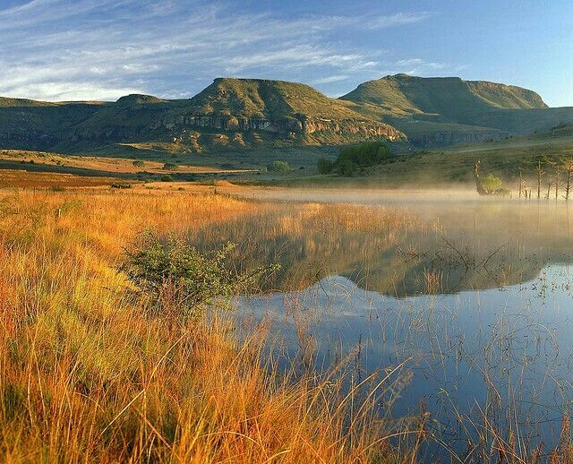 Places of interest in South Africa. Early morning mist rises over the Fouriesburg landscape in South Africa....#wildlife #southafrica #photosafari #tourism #extremefrontiers #bush #adventure #travel #holiday #vacation #safari #tourist