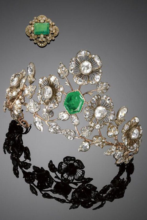 An antique gold, emerald and rose-cut diamond tiara, 1870s. The tiara with en tremblant floral motifs centring a hexagonal emerald and further set with rose-cut diamonds, mounted in gold. #antique #tiara