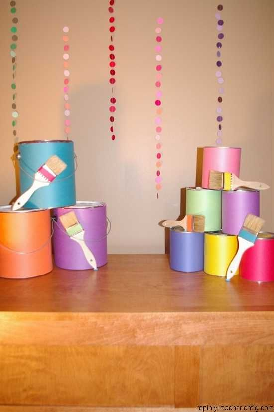 Cover recycled paint cans with bright, colorful paper as an easy decoration for Workshop Of Wonders VBS. #firstpresorangeburgvbs