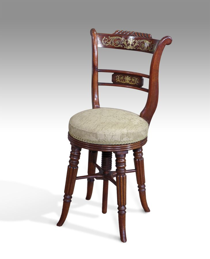 single chairs and pairs regency mahogany music chair with fine brass inlay and scrolling back support
