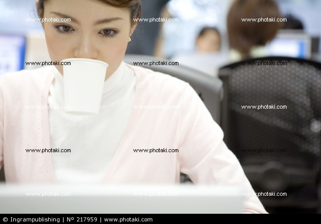 http://www.photaki.com/picture-japanese-office-lady-looking-at-a-monitor_217959.htm