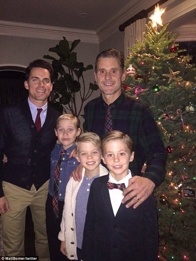 'From my family to yours': Matt Bomer shared a sweet family portrait of himself with his husband Simon Halls and their three children,Kit and twins Walker and Henry on Thursday