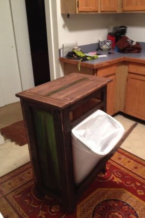 rolling kitchen island with tilt trashcan and holy cutting board do