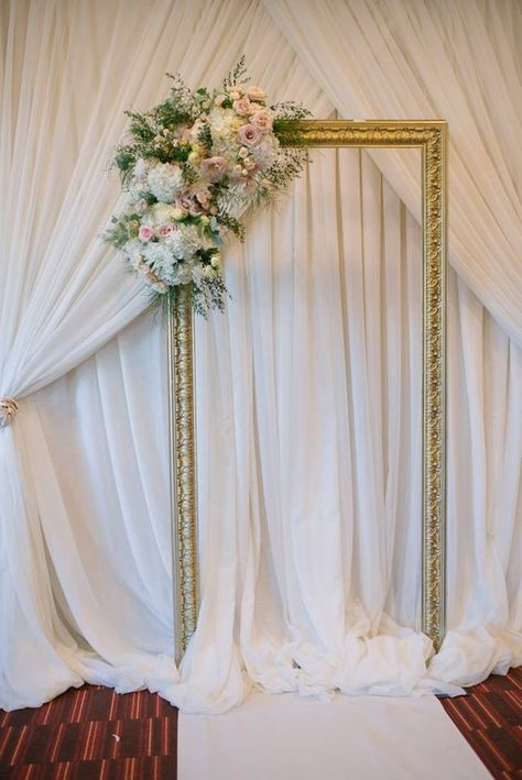 Wedding ceremony frame and floral backdrop created by Akiko Floral Artistry.