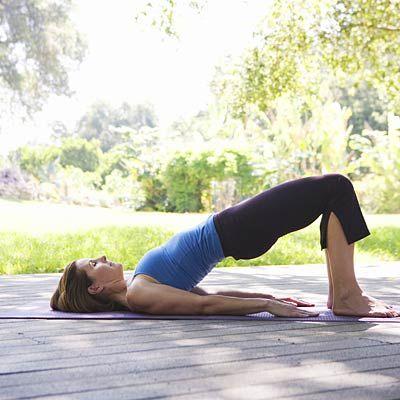 This mild inversion (Bridge Pose) helps your blood flow, making you feel more energized. #yoga #debloat   Health.com